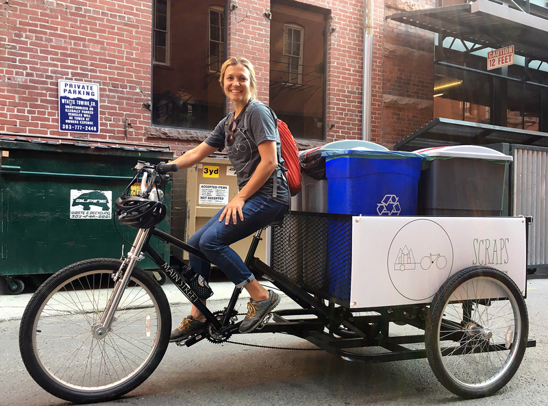 Christi Turner, founder of Scraps, sits on her food-waste hauling tricycle.