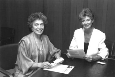 Anna Jo Haynes and Dottie Lamm read The Women's Foundation of Colorado's first newsletter