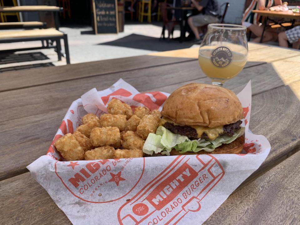 Basket of tater tots and a burger.