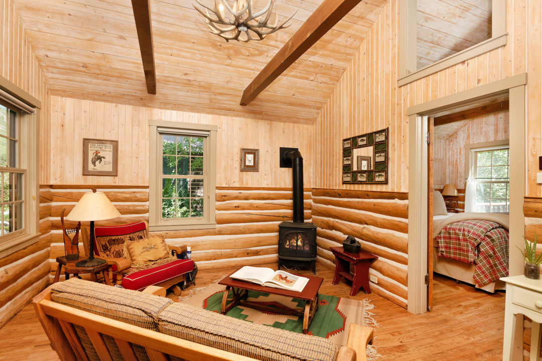 spruce cabin living room Photo courtesy of Coldwell Banker Mason Morse