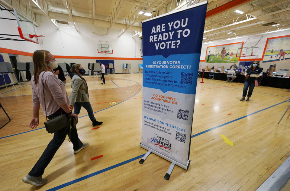 voters visit a polling center in Denver