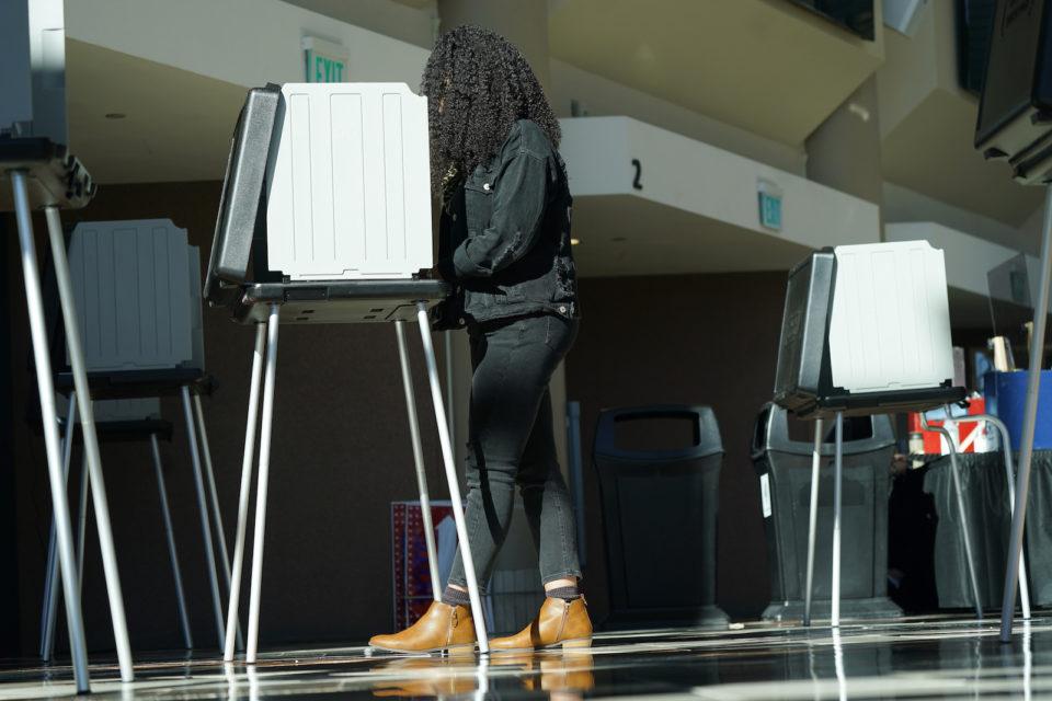 Denver vote in person