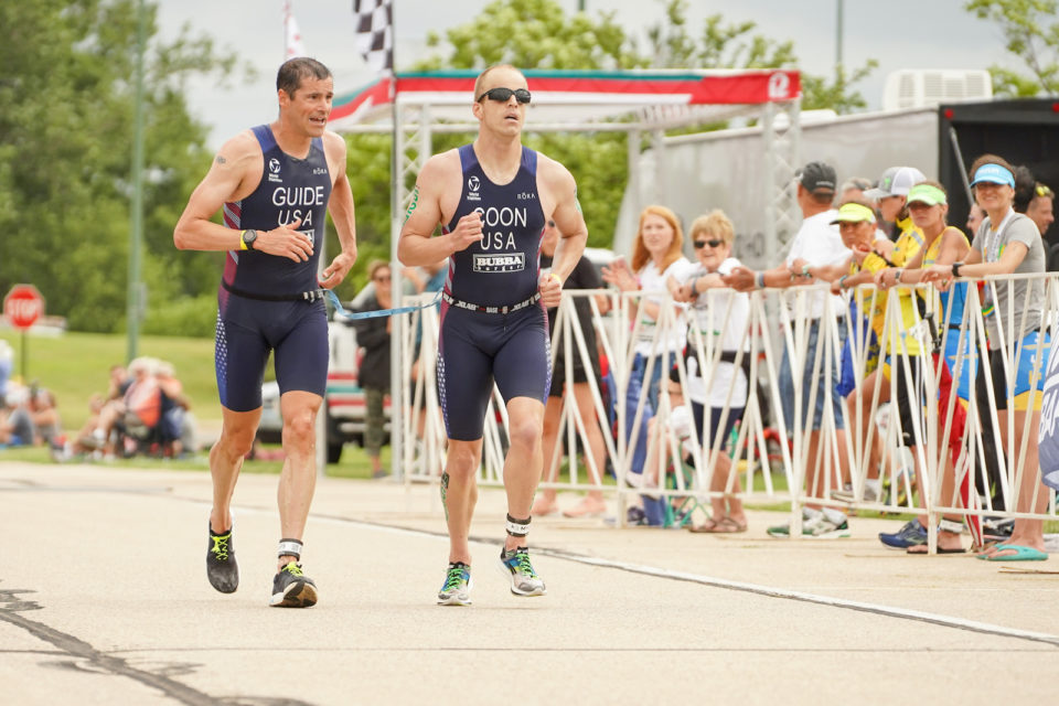 Paralympian Kyle Coon running with his guide, Andy Potts.