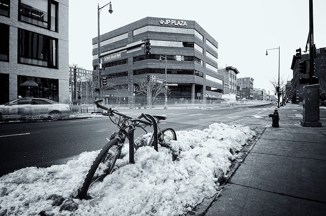 Mountain bike trapped in a mound of hardpacked snow in Denver, Colorado
