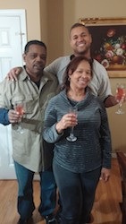 Marcus with his mom and stepdad Curtis over Christmas.