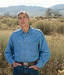 udall-mark_standing-outdoors